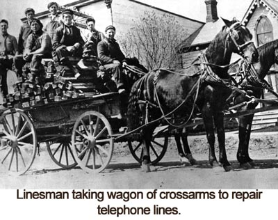 Linesman taking wagon of crossarms to repair telephone lines