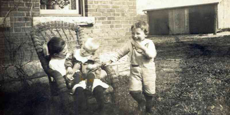 archival photo of children laughing