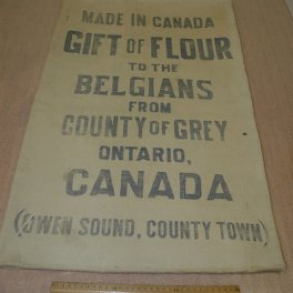 2006.005.001    Printed flour bag sent to Belgium by Grey County, that was found in Mons, Belgium by a Canadian soldier and later returned to Grey.